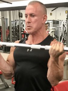 Greg Rando m3 mind muscle memory biceps flex to lift weights in front The Hyper 6 Muscle Strength System