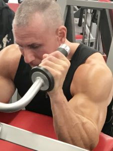 Greg Rando m3 triceps machine stretch to bend arm The Hyper 6 Muscle Strength System