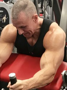Greg Rando m3 tricpes machine flex to straighten arm The Hyper 6 Muscle Strength System