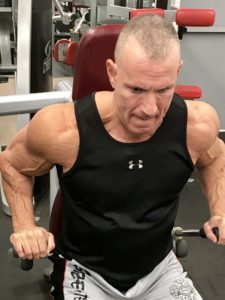Greg Rando mind muscle memory triceps stretch to dip position The Hyper 6 Muscle Strength System